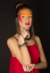 girl in a red dress with bright creative make-up