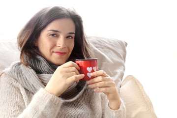 alluring girl drinking something hot inside Valentine decorated