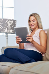Women relaxing with tablet