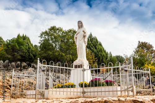 Blessed Virgin Mary Statue on Apparition hill - 76353534