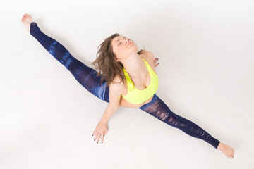 athletic girl doing stretching top view