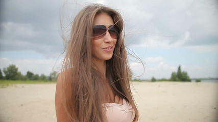 Beautiful Woman Looking And Flirting At Camera With Smile.