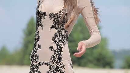 Young attractive woman in a transparent sexy slinky dress