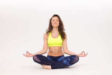 athlete girl sitting in lotus position