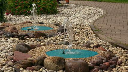 Decorative fountains in the garden. 4K.