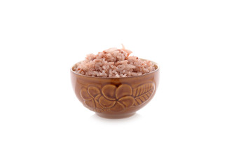 cooked red rice in bowl on white background