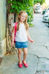 Adorable little girl walking on the street