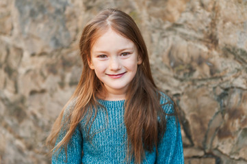 Outdoor portrait of a beautiful little girl of seven years