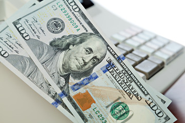 hundred dollar bills on the cash registers background