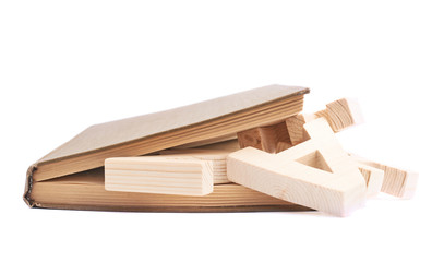Closed book with the wooden letters