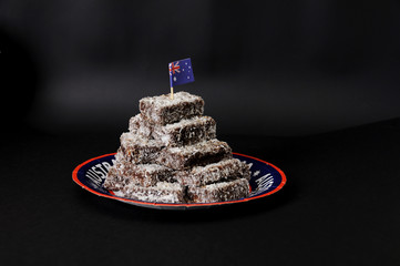 Group of Lamingtons on a black background.