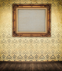 Old-fashioned wooden frame on a wall.