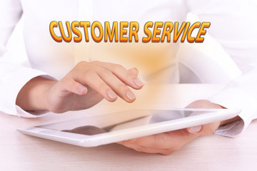 Hands holding tablet PC and Customer Service text
