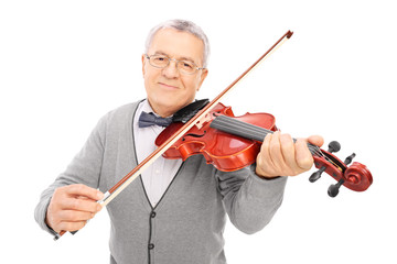 Cheerful old man playing a violin