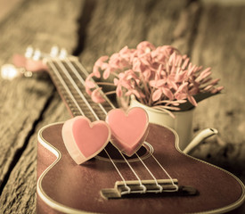 Red heart with guitar.