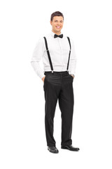 Fashionable young man with bow-tie posing