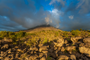 Clouds over the volcanic mountain