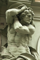 Muscular atlas supporting a Baroque building in Prague