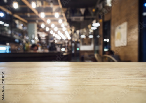 Top of table with Bar Cafe Restaurant blurred background - 76359192