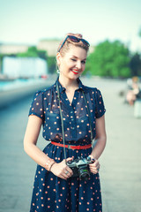 Beautiful young girl in fifties style with braces winking