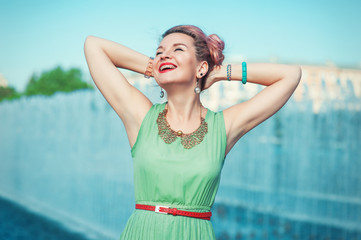 Happy beautiful young woman with braces  in vintage clothing