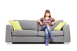 Relaxed woman sitting on a modern sofa