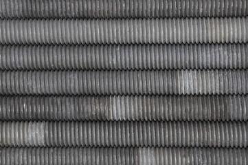 Set of long screws as industrial background