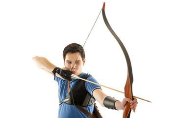 Boy shooting with a longbow