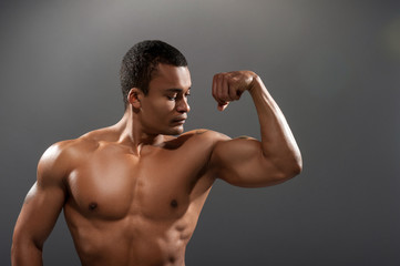Young handsome African man posing shirtless