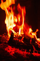 Fireplace burning. Warm burning and glowing fire in fireplace.