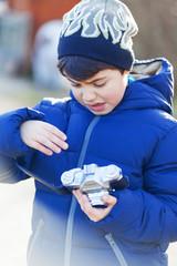 Boy plays with vintage camera in outdoor
