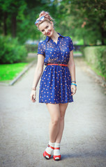 Happy beautiful young girl in fifties style with braces
