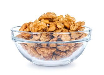 a lot of walnuts in a glass bowl on a white background