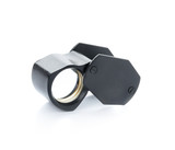 magnify glass for Amulet and jewelry isolate on white - 76363135
