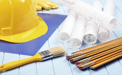 Yellow helmet,meter and brush, home improvement plans