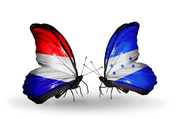 Two butterflies with flags Holland and Honduras