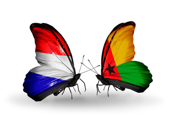 Two butterflies with flags Holland and Guinea Bissau