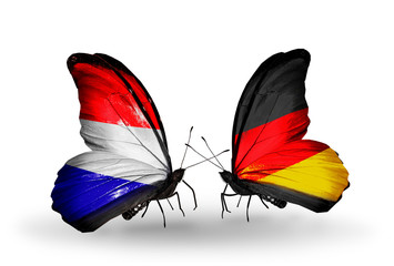 Two butterflies with flags Holland and Germany