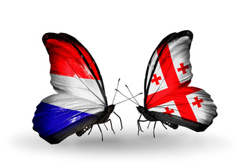 Two butterflies with flags Holland and Georgia