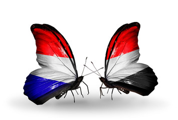 Two butterflies with flags Holland and Yemen