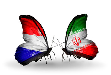 Two butterflies with flags Holland and  Iran