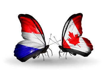 Two butterflies with flags Holland and Canada