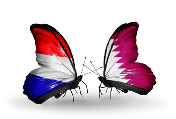 Two butterflies with flags Holland and Qatar