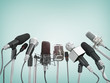 Various microphones aligned at press conference. - 76364764