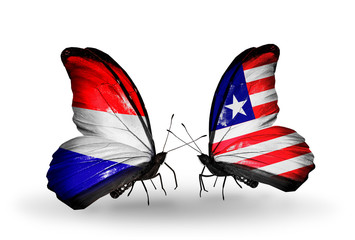 Two butterflies with flags Holland and  Liberia