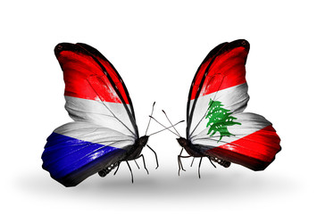 Two butterflies with flags Holland and Lebanon