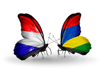 Two butterflies with flags Holland and Mauritius