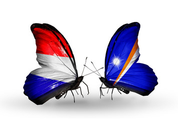 Two butterflies with flags Holland and Marshall islands