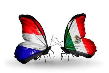Two butterflies with flags Holland and Mexico