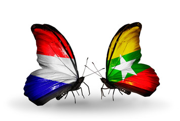 Two butterflies with flags Holland and Myanmar